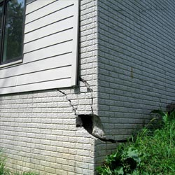 A damaged foundation with wall cracking in Big Timber