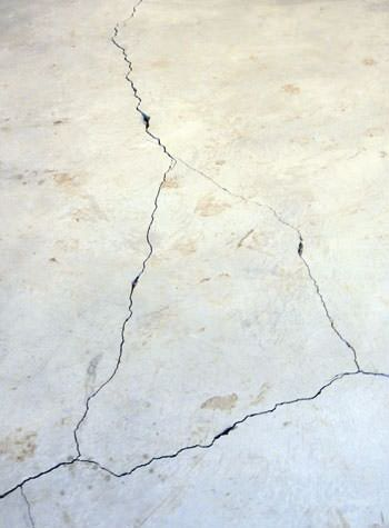 severely cracked, heaving slab floors in a home in Townsend