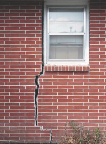 severe foundation wall cracks along a window in Red Lodge